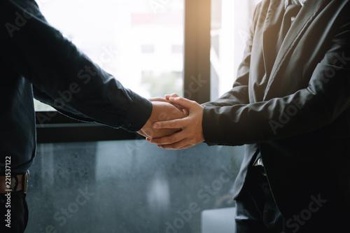 Fotografia Business people holding hands together for support empathy work together