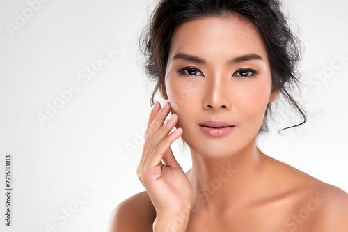 Fotografie, Obraz  Beautiful Young Asian Woman with Clean Fresh Skin