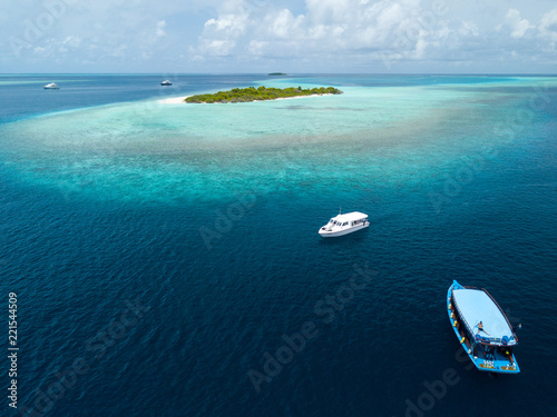 Leinwand Poster Aerial view of the Maldives, Baa Atoll.