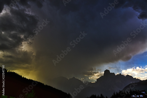 Foto op Aluminium Onweer Storm clouds and downpour in mountains
