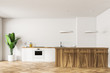 White kitchen interior with bar and stools