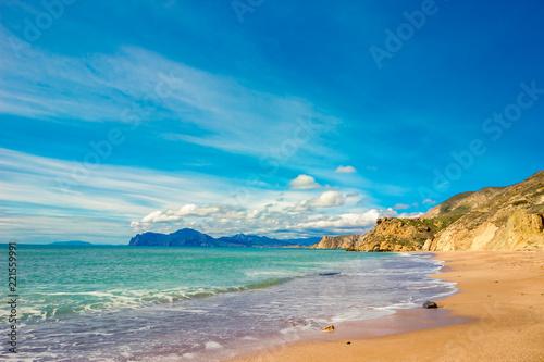 Scenic seascape. Landscape with blue sea and sand shore