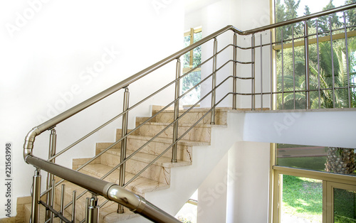 Stairs in the building with metal handrail Fotobehang