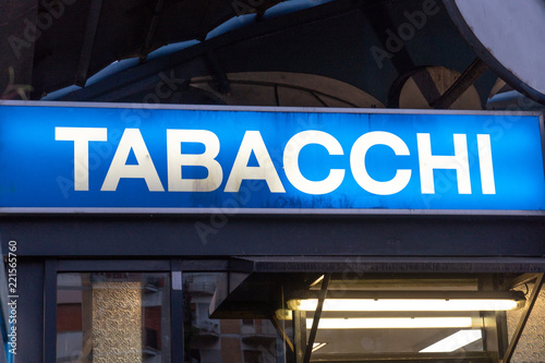 Fotografía Blue signage of a Tabacchi, Italian for Tobacco shop, on a black background