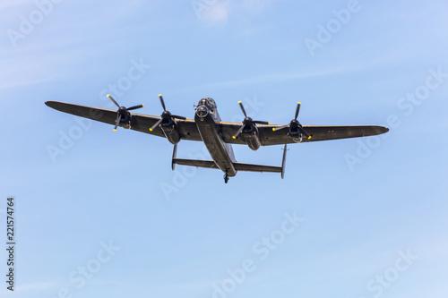 Fotografía Old wartime air-plane Lancaster Bomber in flight during memorial WW2 day