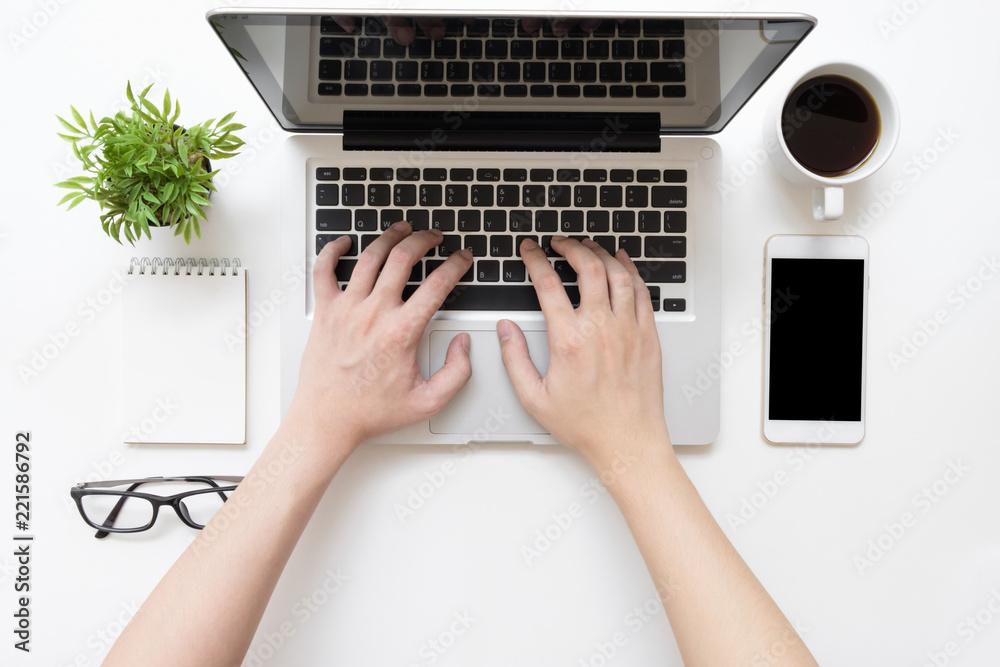 Fototapeta Man is typing on laptop keyboard, top view.