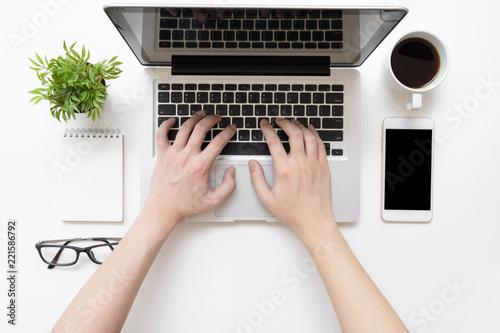 Fotografia Man is typing on laptop keyboard, top view.