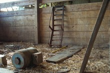 Rusted Farming Implement In An Abandoned Barn