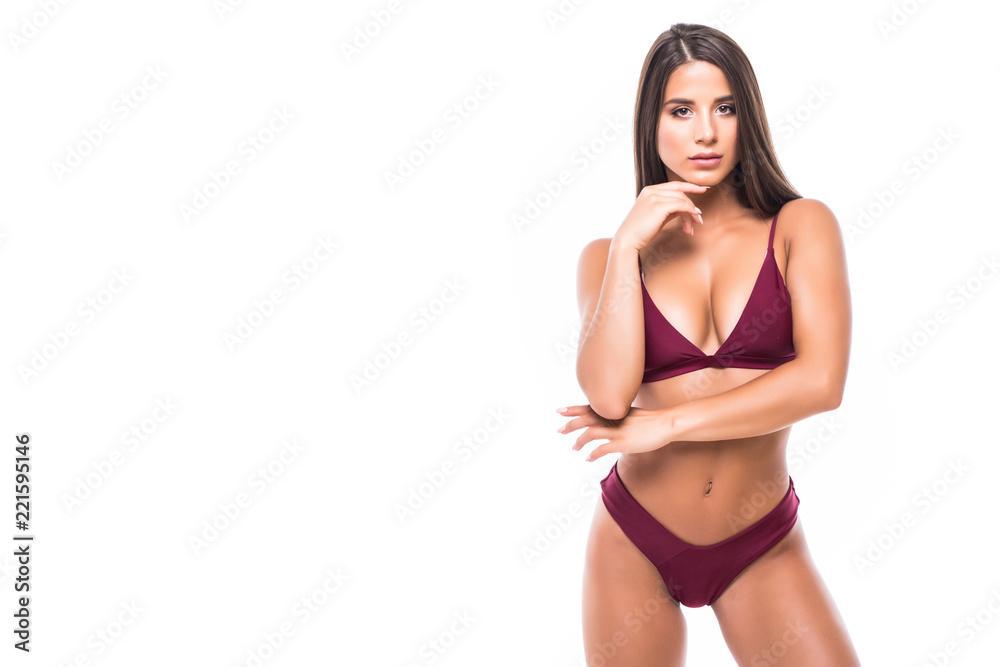 Fototapeta Young woman with beautiful slim perfect body in bikini isolated white background - obraz na płótnie