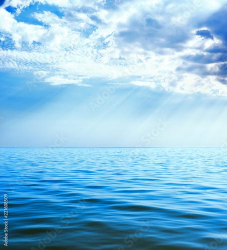 Staande foto Zee / Oceaan clouds with rays over blue sea