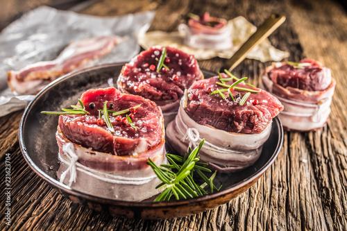 Beef tenderloin steak wrapped in bacon stored into the pan Wallpaper Mural
