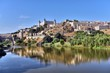 Toledo, Spain old town skyline at the Alcazar on the Tagus River