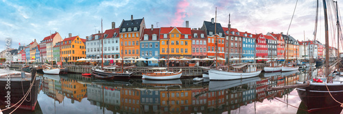 Poster Scandinavie Nyhavn at sunrise, with colorful facades of old houses and old ships in the Old Town of Copenhagen, capital of Denmark.