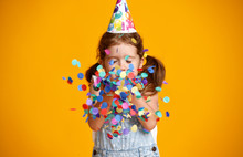 Happy Birthday Child Girl With Confetti On Yellow Background