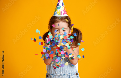 Spoed Foto op Canvas Carnaval happy birthday child girl with confetti on yellow background