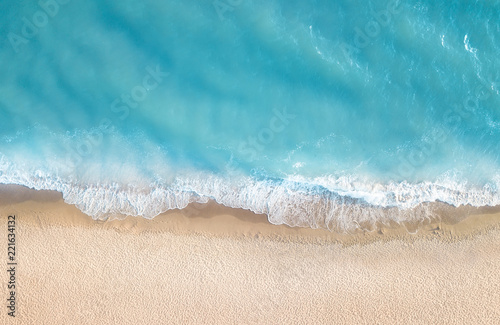 Deurstickers Luchtfoto Beach and waves from top view. Aerial view of luxury resting at sunny day. Summer seascape from air. Top view from drone. Travel concept and idea