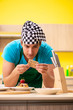 canvas print picture - Man cook preparing cake in kitchen at home