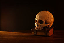 Human Skull And Old Book Over ...