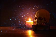 Human Skull, Old Book And Burn...