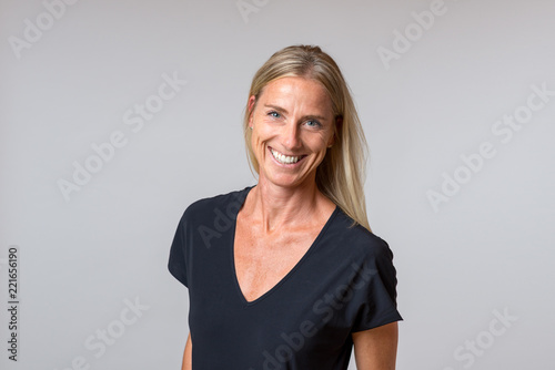 Attractive happy blond woman with a enthusiastic smile Tableau sur Toile