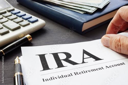 Fototapeta Documents about Individual retirement account IRA on a desk. obraz