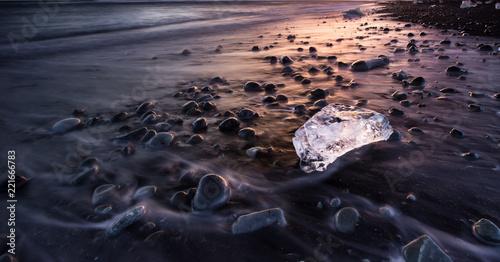 Icebergs in Jokulsarlon glacial lake during sunset, Iceland