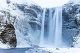 Beautiful Skogafoss waterfall in winter. Iceland.