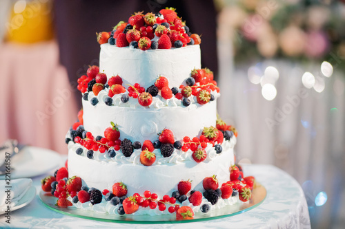 Fotografia, Obraz  White layer cake decorated with berries, served with fireworks