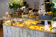 Modern display of bakery with different kinds of cookie and buns
