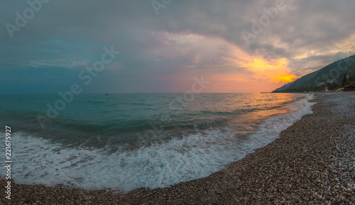 Spoed Foto op Canvas Zee zonsondergang The picturesque sea at sunset. Sunset on the Black Sea with the sun. Georgia, Abkhazia. Colorful sunset with waves.