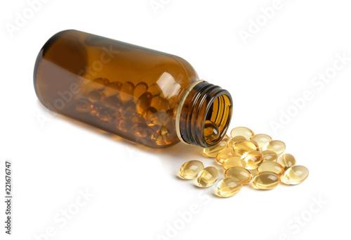 Fototapeta Bottle with cod liver oil pills on white background obraz na płótnie