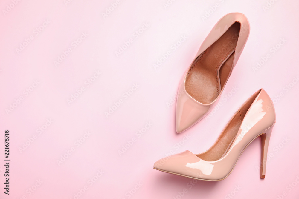 Fototapeta Pair of beautiful shoes and space for text on color background, top view