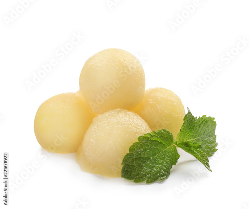 Melon balls and mint on white background