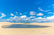 Freshwater lagoons in the middle of a white sand desert, clouds in the sky