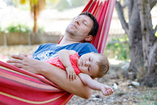 Cute Adorable Baby Girl Of 6 Months And Her Father Sleeping Peaceful In Hammock In Outdoor Garden. Closeup Of Beautiful Child, Little Newborn Kid Sleeping. Tired Dad, Man In Bed With Daughter