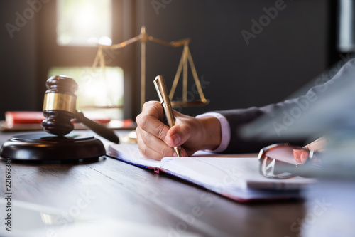 Fotografia  Judge gavel with Justice lawyers, Business woman in suit or lawyer working on a documents