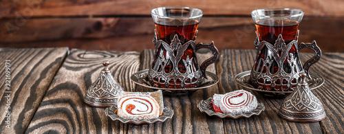 Foto op Plexiglas Stenen in het Zand Fragrant Turkish tea and Turkish sweets in national dishes, panoramic banner