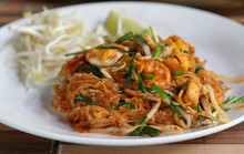 Pad Thai, Thai Fried Rice Noodles With Shrimp And Vegetables On White Plate.
