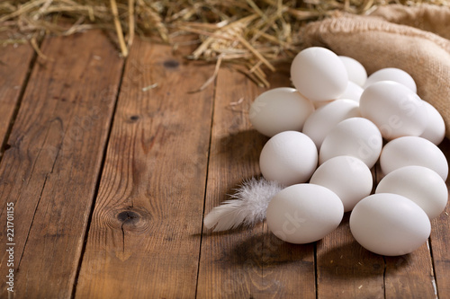 white eggs on wooden table