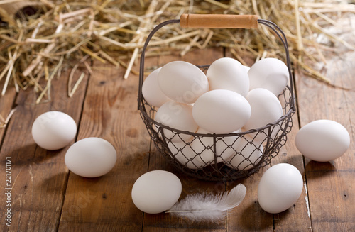 basket of eggs on wooden table