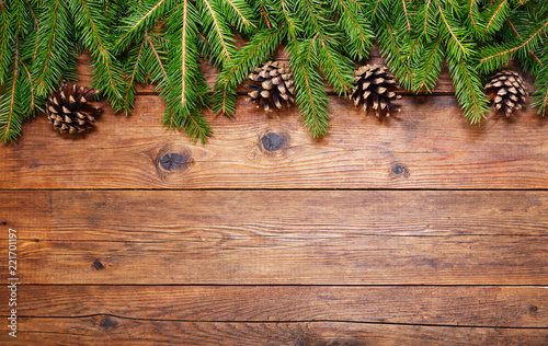 Papiers peints Nature Christmas wooden background with fir branches and cones, top view