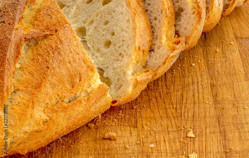 Poster Brood Close-up fresh baked bread and slices on wooden board