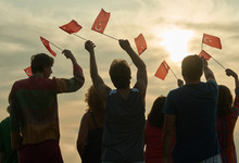Group Of People With Turkish Flags. Back View Silhouette Of Turkish Family.
