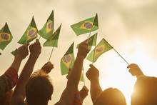 Hands Holding Brazil Flags. To...