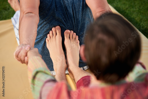 Fototapety, obrazy: Young therapist feet doing thai massage. Caucasian men practising yoga together.