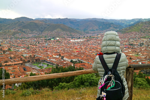 Spoed Foto op Canvas Zuid-Amerika land Female tourist looking at the breathtaking aerial view of the city center of Cusco from Sacsayhuaman citadel, UNESCO World Heritage Site in Peru