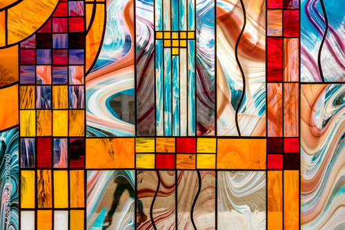 Valokuva  image of a multicolored stained glass window with an irregular block pattern, an