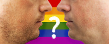 Two Lovers Face To Each Other Against The Background Of The LGBT Flag With A Question Mark