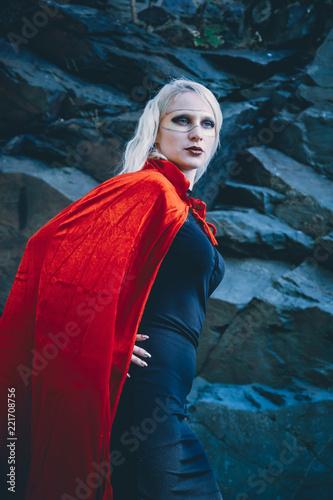 Fototapeta Angled view of woman wearing cape and mask obraz na płótnie