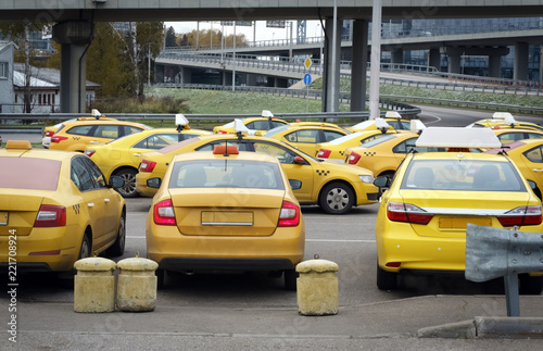 Cars from service Yandex Taxi wating for the order at the parcking